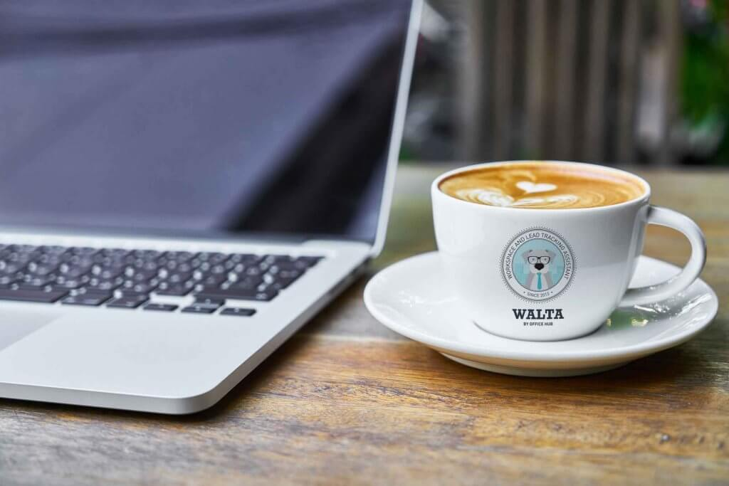 WALTA-coffee-cup-next-to-laptop-2